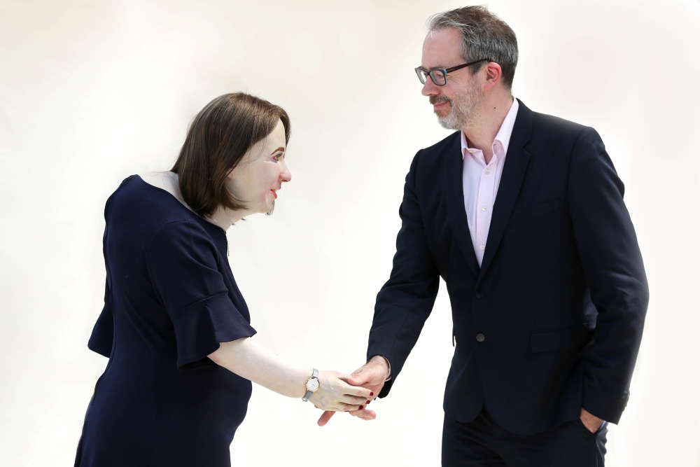Emma Shaking Her Boss Hand