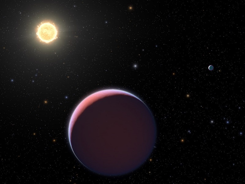illustration of the sun like star Kepler 51 and two of its three giant super puff planets