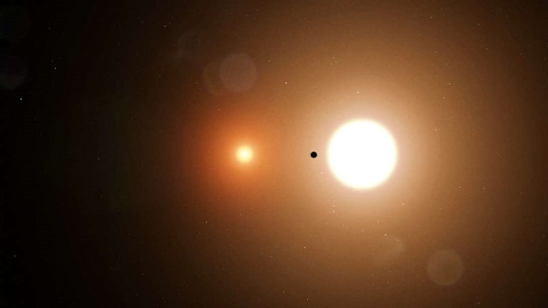 artists impression of TOI 1338 B silhouetted against its host stars