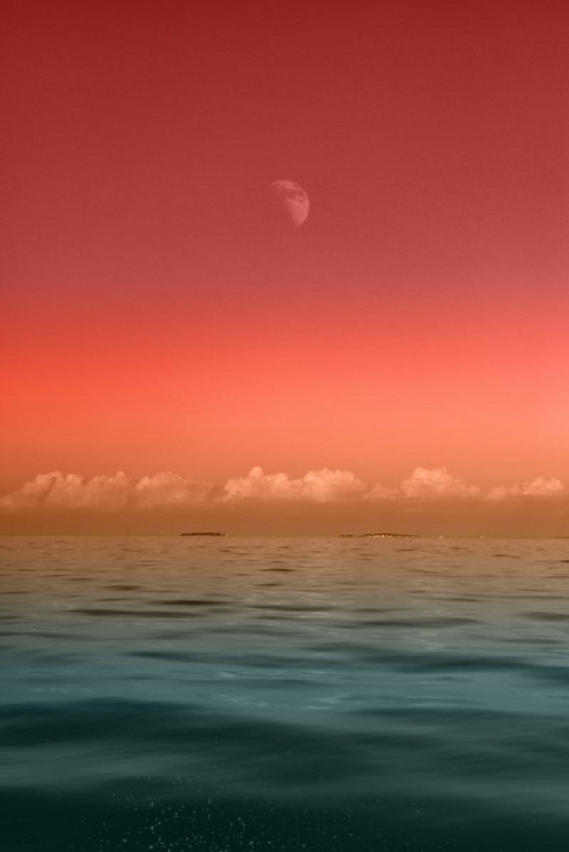 Sea under half moon